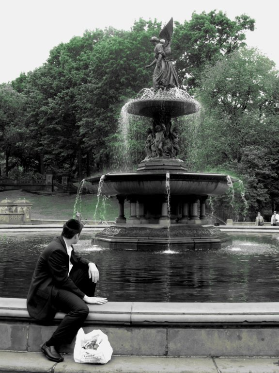 MAN AT THE FOUNTAIN