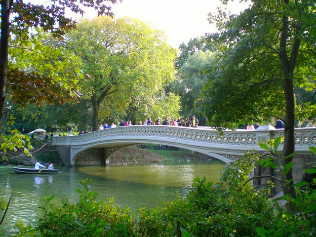 Bow Bridge amidst changing leaves