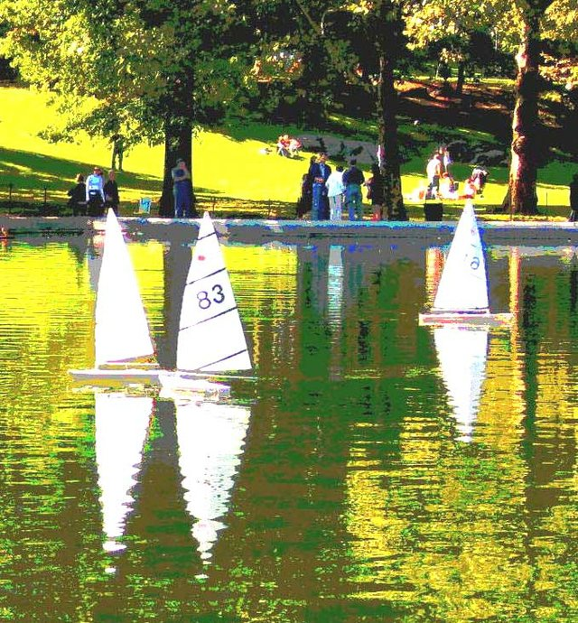 3 sailboats in the city
