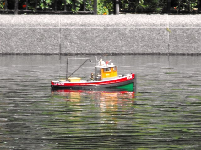 Fishing boat in the pond