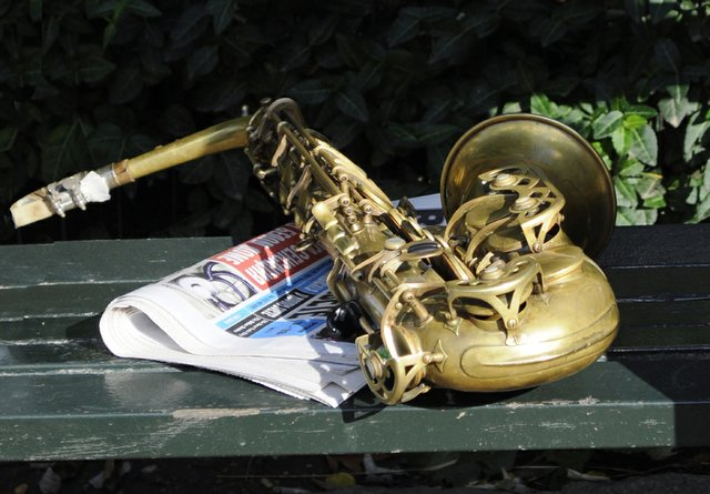 Brass horn and paper