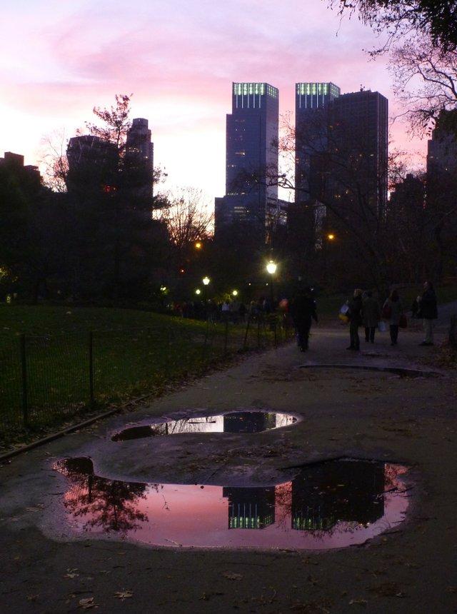 Puddle reflecting pastel sunset