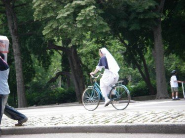 nun on a bike
