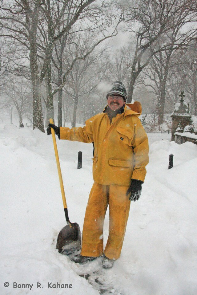 Harry shoveling as the snow falls